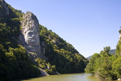 Statue of Decebalus. The Statue of Dacian king Decebalus is a 40-meter high statue that is the tallest rock sculpture in Europe. It is located on the Danube's Royalty Free Stock Photo