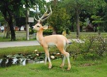 Statue of deer in the garden. Beautiful statue of deer in the garden Stock Photos