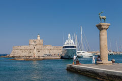Statue Deer and hound and columns in Mandraki harbor. Royalty Free Stock Photography