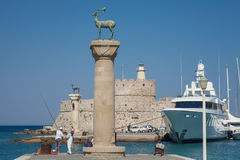 Statue Deer and hound and columns in Mandraki harbor. Stock Photography