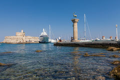 Statue Deer and hound and columns in Mandraki harbor. Royalty Free Stock Image