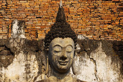 Statue of a deity in historical park Sukhothai. Royalty Free Stock Photo