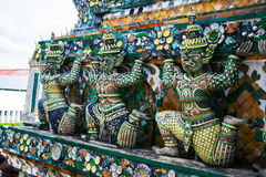 Statue of demon (Giant, Titan) at Wat Arun, Landmark and No. 1 tourist attractions in Thailand. Royalty Free Stock Image