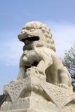 Statue di pietra grige del leone, stile tradizionale cinese antico dell'AR Fotografia Stock Libera da Diritti