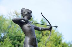 Statue of Diana the Huntress. With tres in background Stock Photography