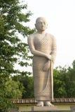 Statue of Disciple of Buddha. Standing in tranquil mood, Bodhgaya, Bihar, India, Asia Royalty Free Stock Image