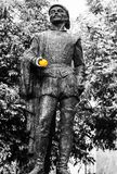 Statue of Don Juan in Seville, Spain with orange fruit in the hand. Black and white colors stock images