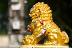 Statue dorate del leone. Fotografie Stock