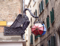 Statue of a dragon holding umbrellas in Venice, Italy Royalty Free Stock Image
