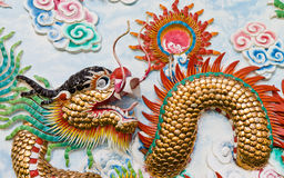 Statue of a dragon on the wall. Stock Photo