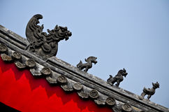 Statue of dragons on the roof of Chinese temple. China Royalty Free Stock Photo