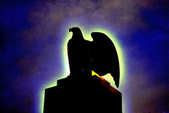 Statue of eagle. Silhouetted against night sky Royalty Free Stock Photos