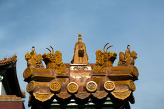 Statue on the eaves of ancient building Royalty Free Stock Photography