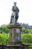 Statue in Edinburgh, Scotland with castle in background Stock Images