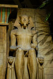 Statue Egyptian Pharaoh sitting Stock Images