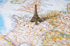 Statue of Eiffel Tower on a map Stock Photos
