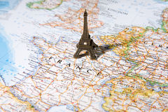 Statue of Eiffel Tower on a map, Paris most romantic city. Statue of Eiffel Tower on a map of France, Paris most beautiful destination in the world Stock Images
