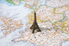 Statue of Eiffel Tower on a map, Paris most romantic tourist destination. Statue of Eiffel Tower on a map, Paris most beautiful destination in the world Stock Photography