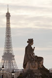 Statue and Eiffel Tower in Paris Royalty Free Stock Image