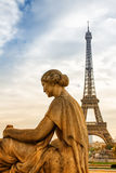 Statue and Eiffel Tower Stock Image