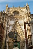 The statue of El Giraldillo and the Cathedral of Seville. The cathedral, one of the largest churches in the world and an outstanding example of the Gothic and Royalty Free Stock Images
