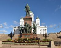 Statue of Emperor Alexander II in center of Senate square on background of Helsinki Cathedral. Autumn in Helsinki, Finland. Statue of Emperor Alexander II in royalty free stock photos