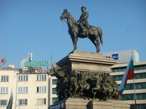 Statue of emperor Alexander II on horseback on a pedestal to Sofia in Bulgaria. Blue clear sky. Sunny day. Travel destination. Flag of the Bulgaria. Modern Royalty Free Stock Image