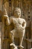 Statue en pierre d'un roi céleste dans le Longmen Gro Images stock