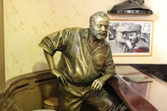 Statue of Ernest Hemingway in bar Floridita in Havana, Cuba. Where he used to drink Royalty Free Stock Photos