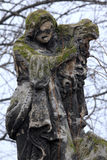 Statue. Eroded, weathered cemetery tombstone sculpture Stock Photography