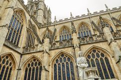 Statue and exterior of Bath Abbey, Bath, England Royalty Free Stock Images