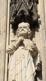 statue on facade of cathedral in Koeln Stock Image