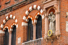 Statue on the facade House of Merchants in Verona, Italy. Statue on the facade House of Merchants ( Domus Mercatorum or Casa dei Mercanti ) in Piazza delle Erbe Stock Photo