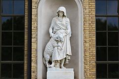 Statue in facade of palace in Sans Souci Stock Images
