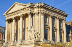 Statue and facade of the Palace of Versailles Stock Images