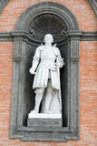 Statue on facade of the Palazzo Reale Stock Photo