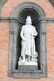 Statue on facade of the Palazzo Reale Stock Image