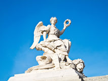 Statue at facade of Versailles Chateau entrance Stock Images