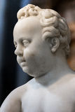 Statue face, child angel Stock Photos