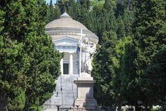 Statue of Faith or Religion and Pantheon in monumental cemetery of Genoa, Italy. Statue of Faith or Religion and Pantheon in monumental cemetery of Genoa, Italy Stock Photo