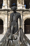 Statue of famous bullfighter in front of the arena in Nimes, France Royalty Free Stock Photography