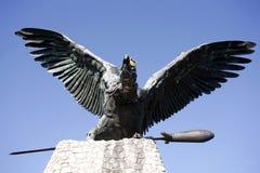 Statue of the famous hungarian legendary Turul bird against blue Stock Photos