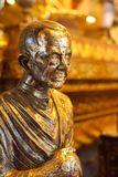 Statue of famous monk covered by gold leaf sheets in main hall of Wat Phumin or Phu Min Temple, The famous ancient temple in Nan,
