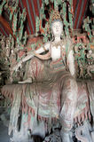Statue of female buddhist deity Stock Photo