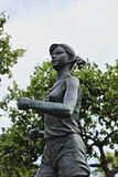 Statue of a female marathon  runner Stock Photos