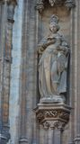 Statue of a female saint on a christian church Stock Images