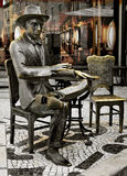 Statue of Fernando Pessoa outside of Cafe A Brasileira in Lisbon Royalty Free Stock Images