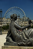 Statue and ferris wheel Stock Image