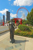Statue, ferris wheel and cityscape at Navy Pier in Chicago, Illi Stock Photo