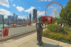 Statue, ferris wheel and cityscape at Navy Pier in Chicago, Illi Royalty Free Stock Image